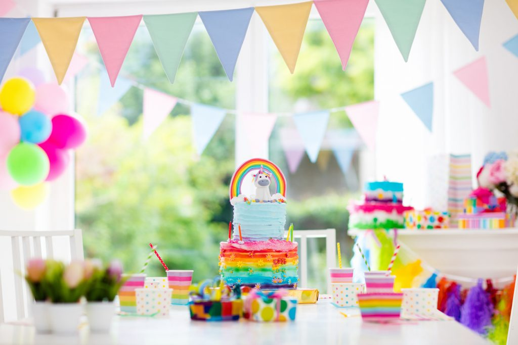 Rainbow banners and unicorn decor for birthday party