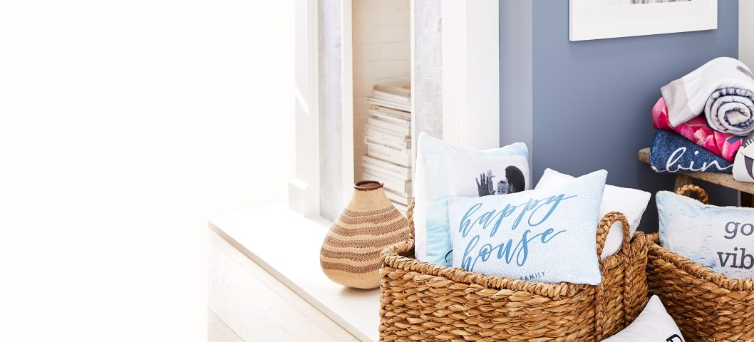 living room corner with baskets and pillows