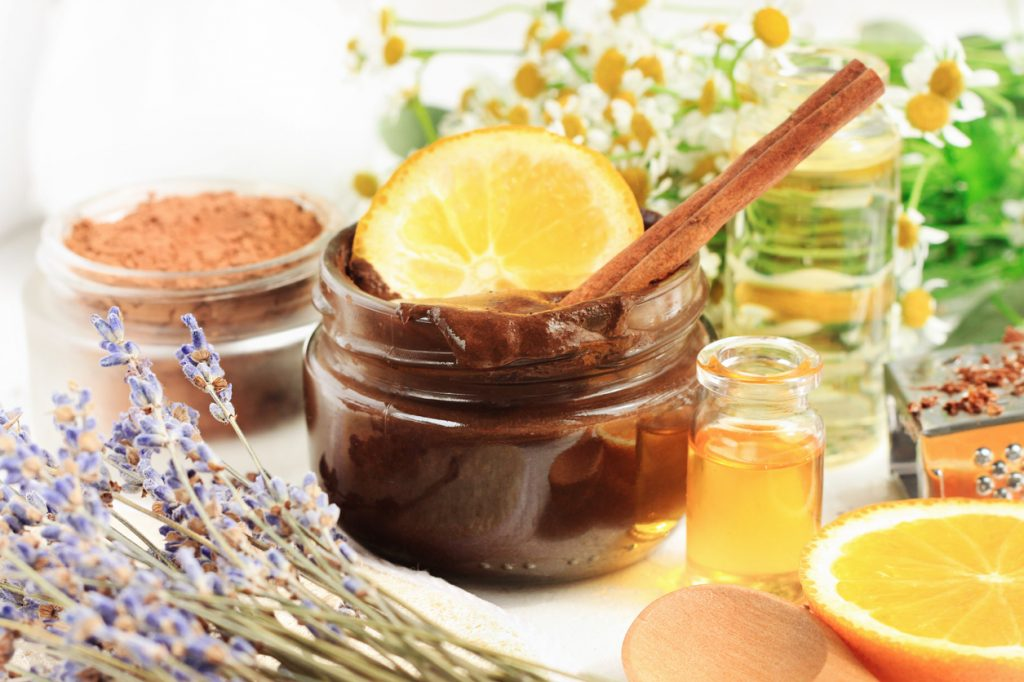 Jar of chocolate sugar scrub with aroma orange oil and lavender blossom.