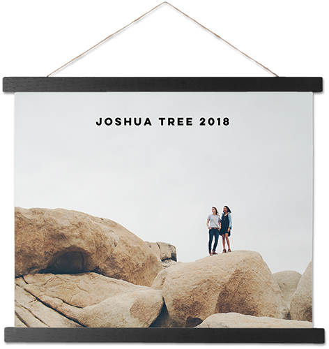 A hanging canvas of a summer trip with the caption joshua tree