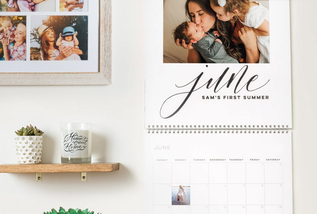 family wall calendar next to a candle