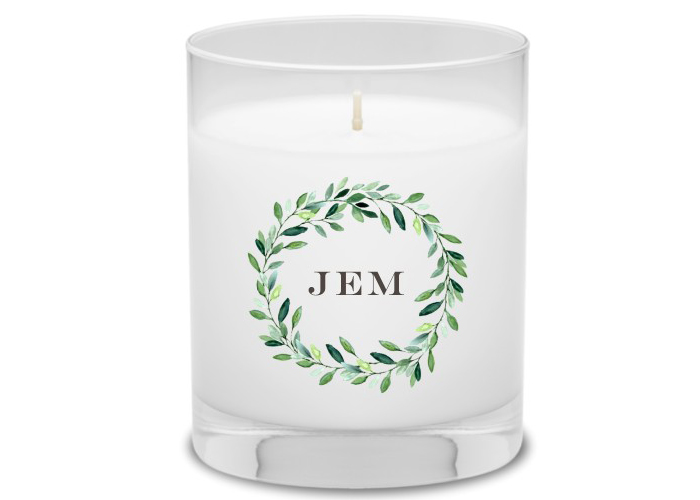 Personalized candle with foliage design for a gift.