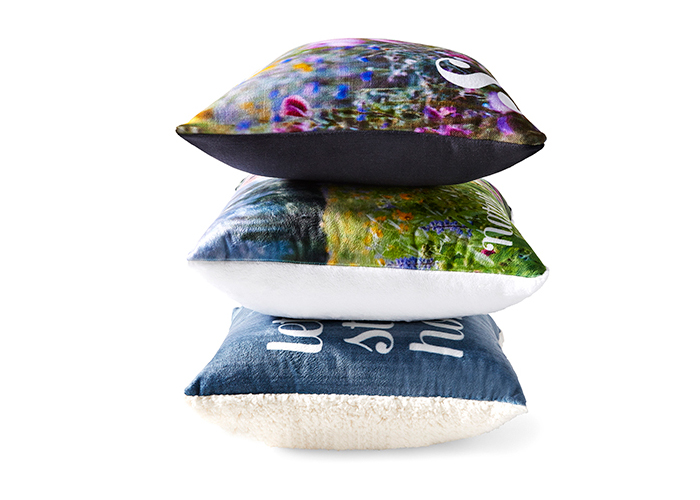 A stack of personalized pillows for gifts.