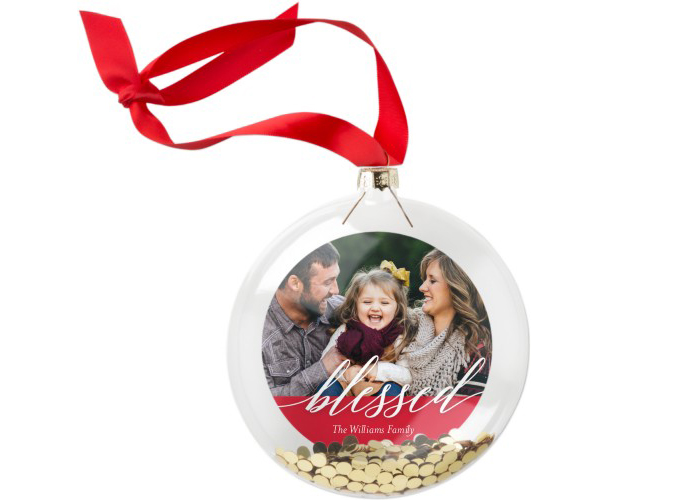 A family photo in a blessed Christmas ornament.