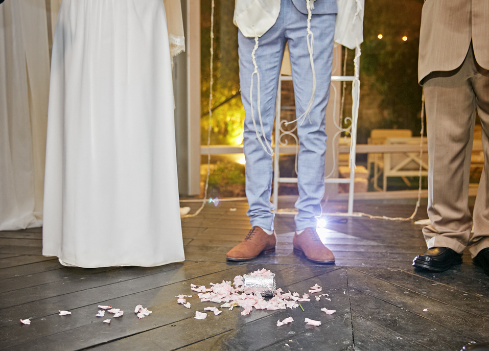 Groom breaking a glass at a Jewish wedding.