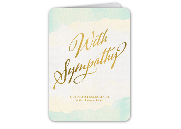A Sympathy card with gold lettering.