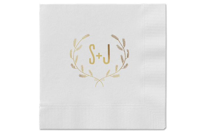 A set of personalized wedding napkins with initials.