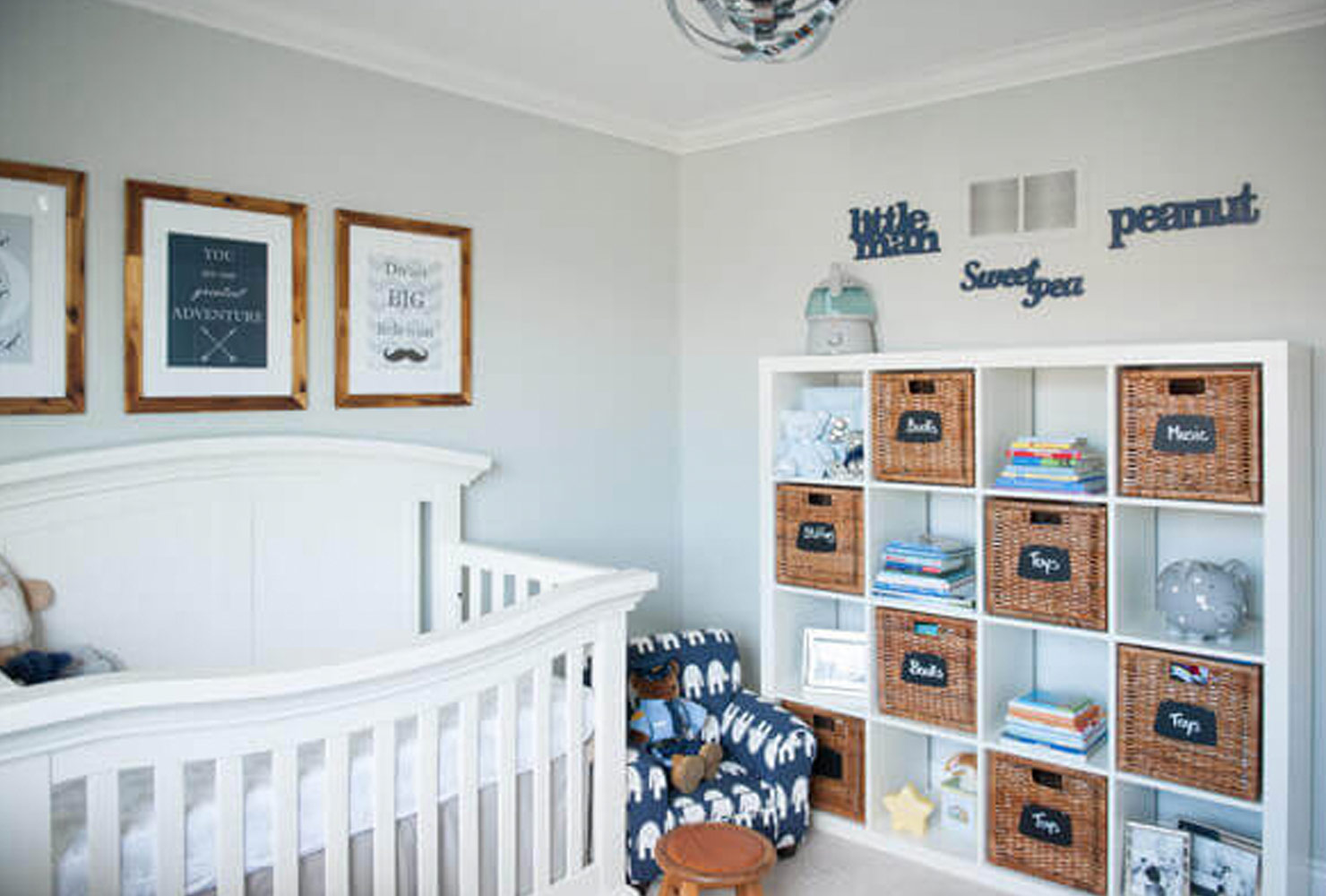 White and gray nursery with cube storage.