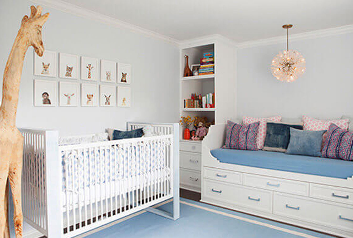 Pasel blue and gray nursery with crib.