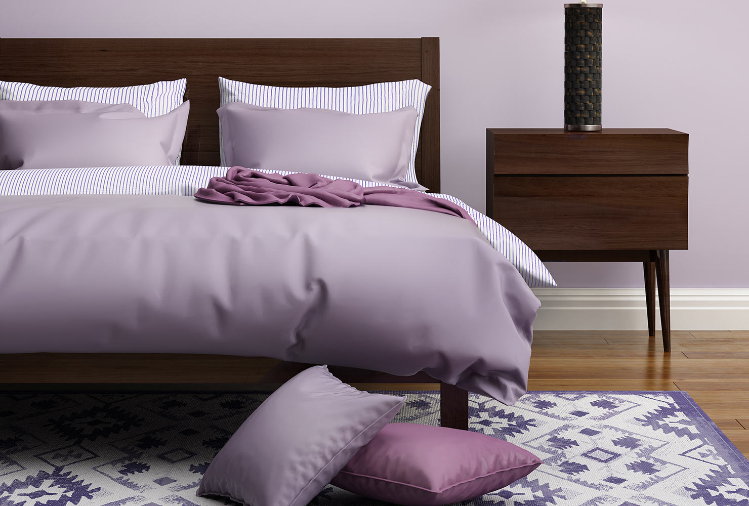 Purple bed decor with tribal rug.