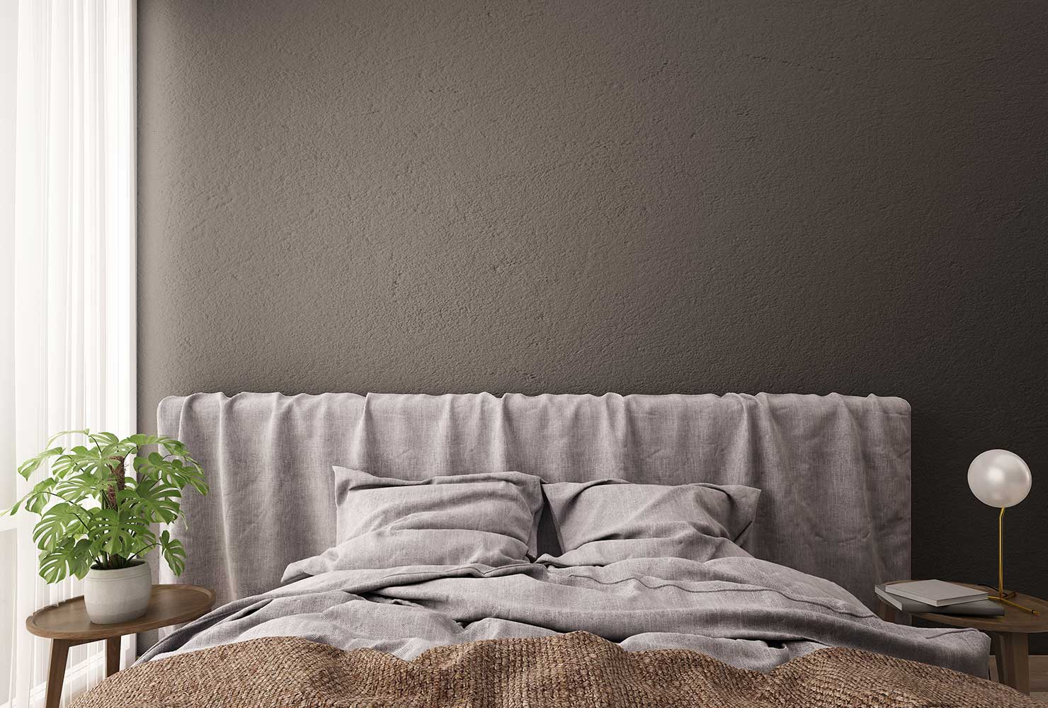 Taupe colored wall with purple bedding and plant.
