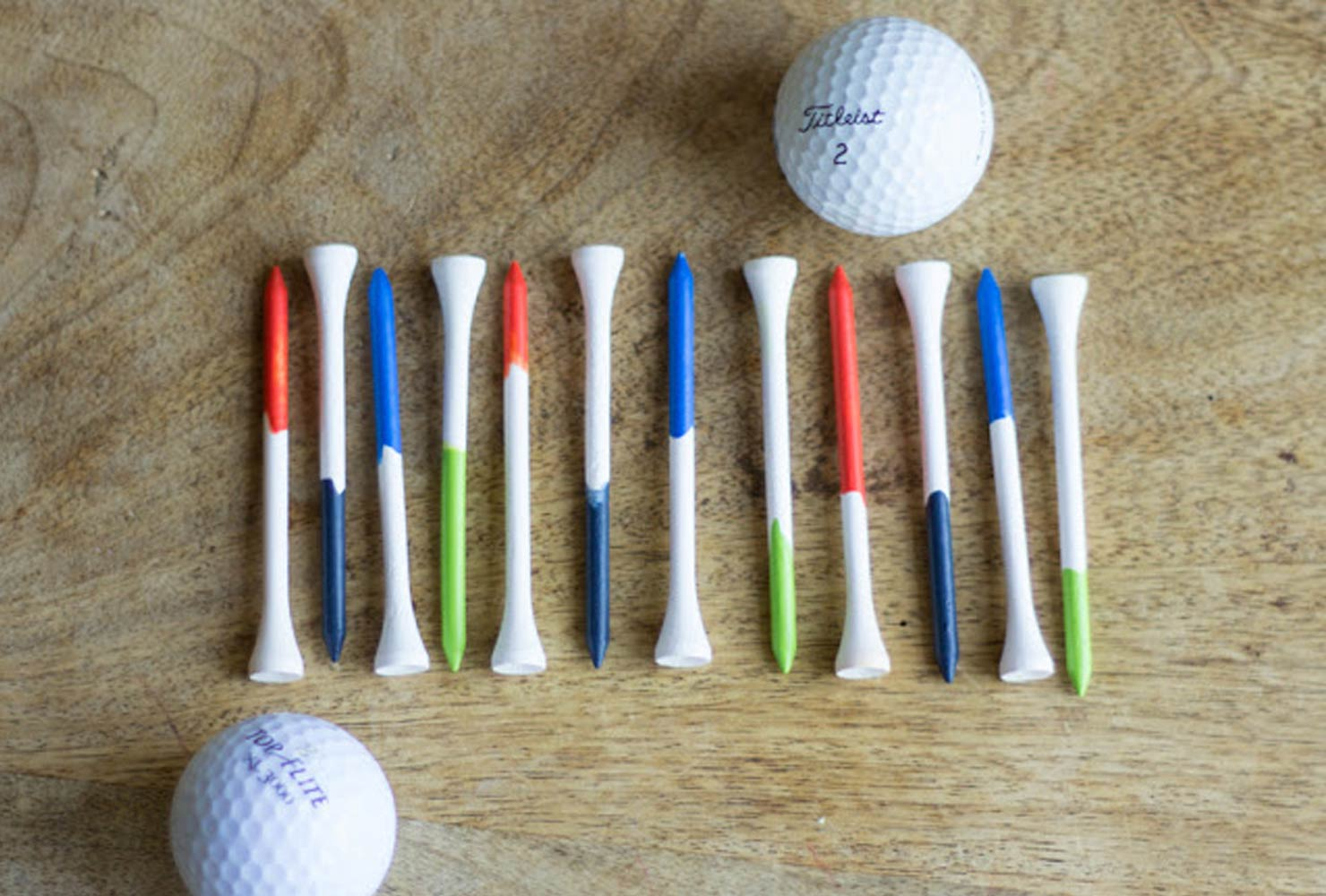 Paint dipped golf tees and golf balls.