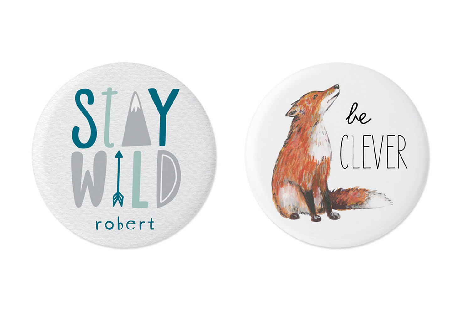 White, blue and gray pins with name, stay wild and fox.