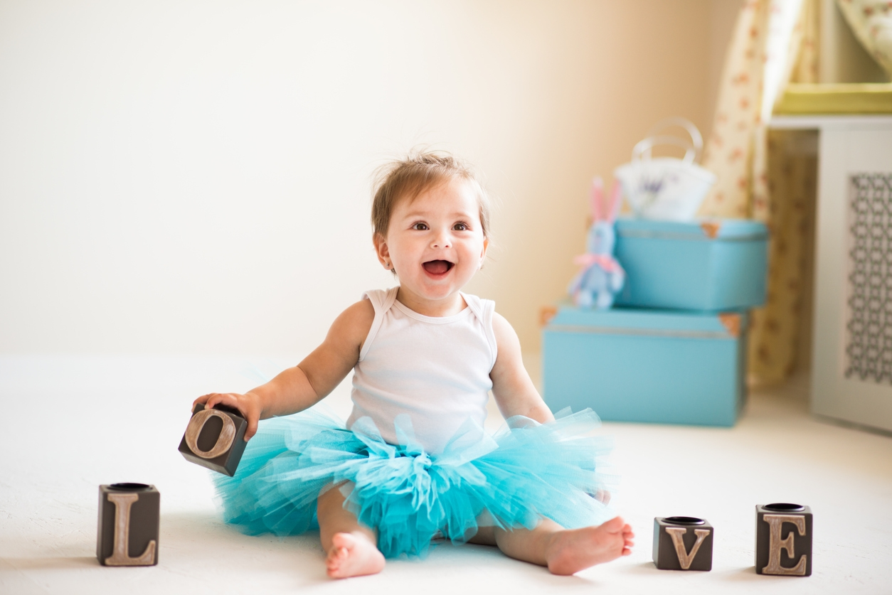 One year old girl, portraits in studio interior.