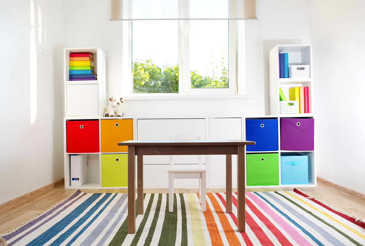 Rainbow color coded shelves.