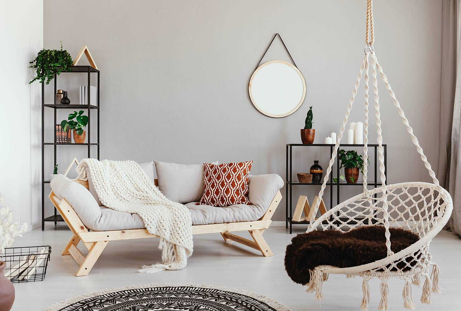 Bohemian living room decor with hanging swing.