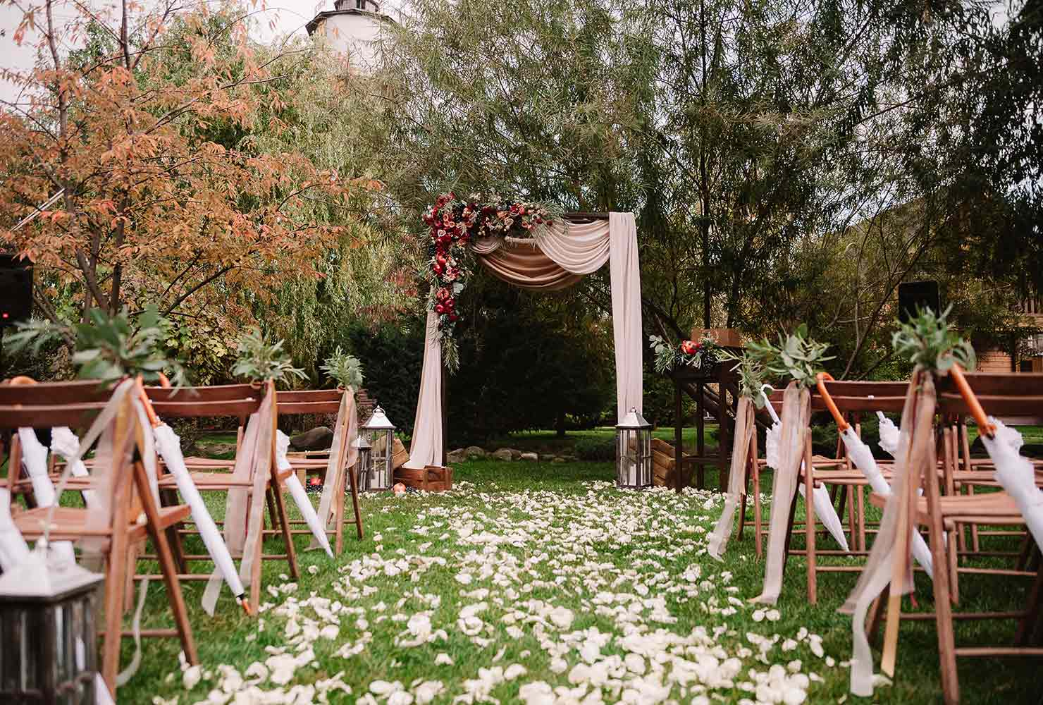 Ceremony aisle outdoors with fall colors.