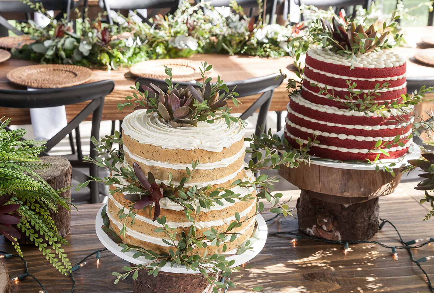 Tall rustic wedding cakes on table.