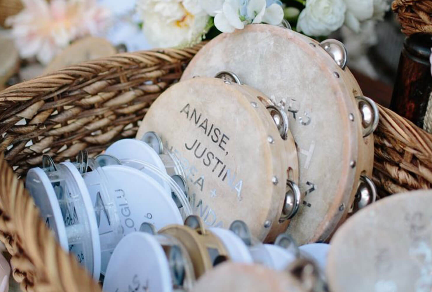 personalized tambourines in a basket.