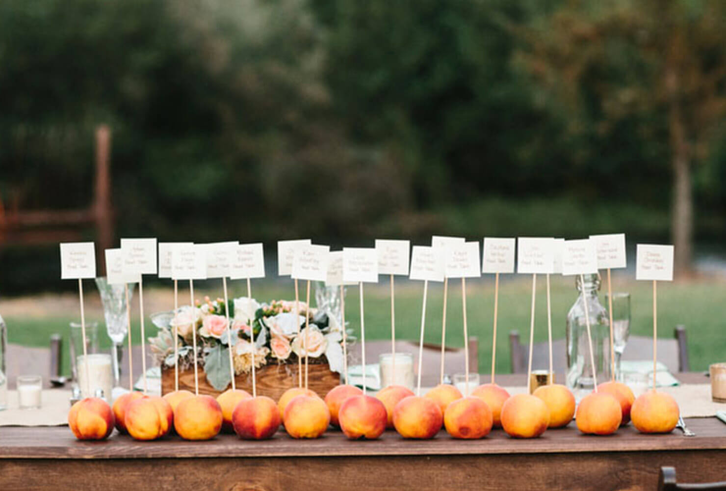 colorful peaches on a table with wedding name cards.