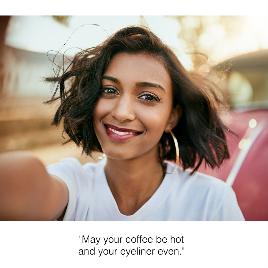 Selfie of a girl taking a photo on the street with a caption below.