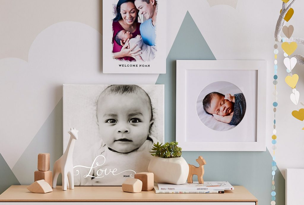 Newborn photo prints in nursery with colorful decor