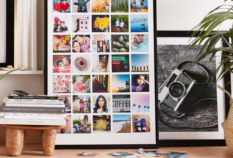 Colorful art prints propped on the ground in home