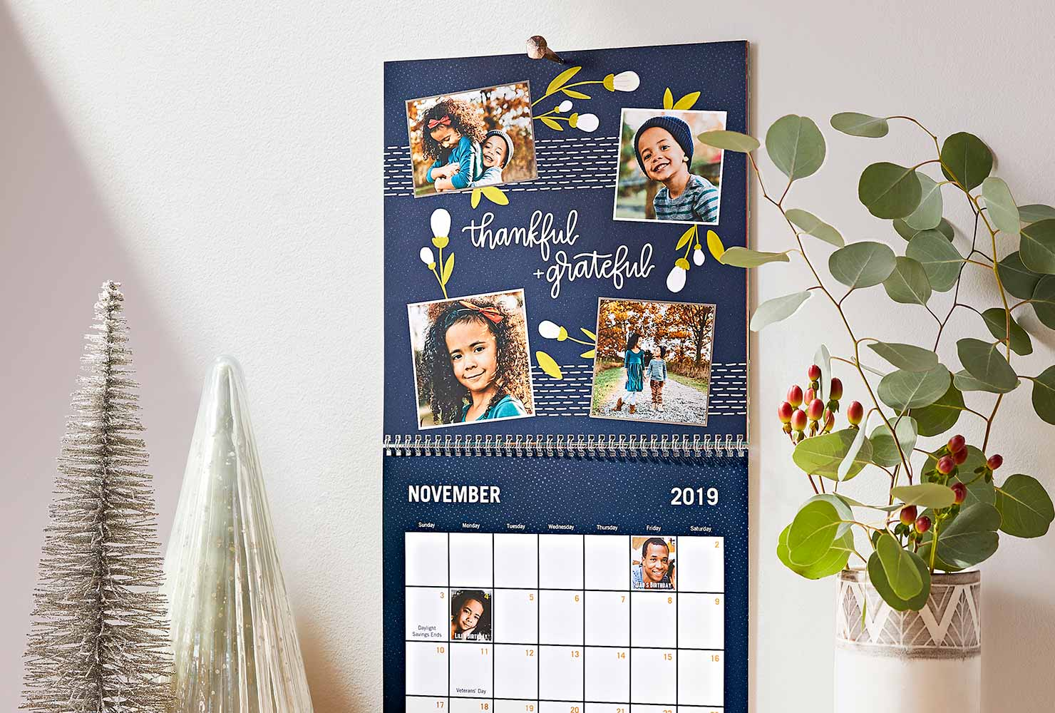 Wall calendar with photos of young girl with holiday home decor