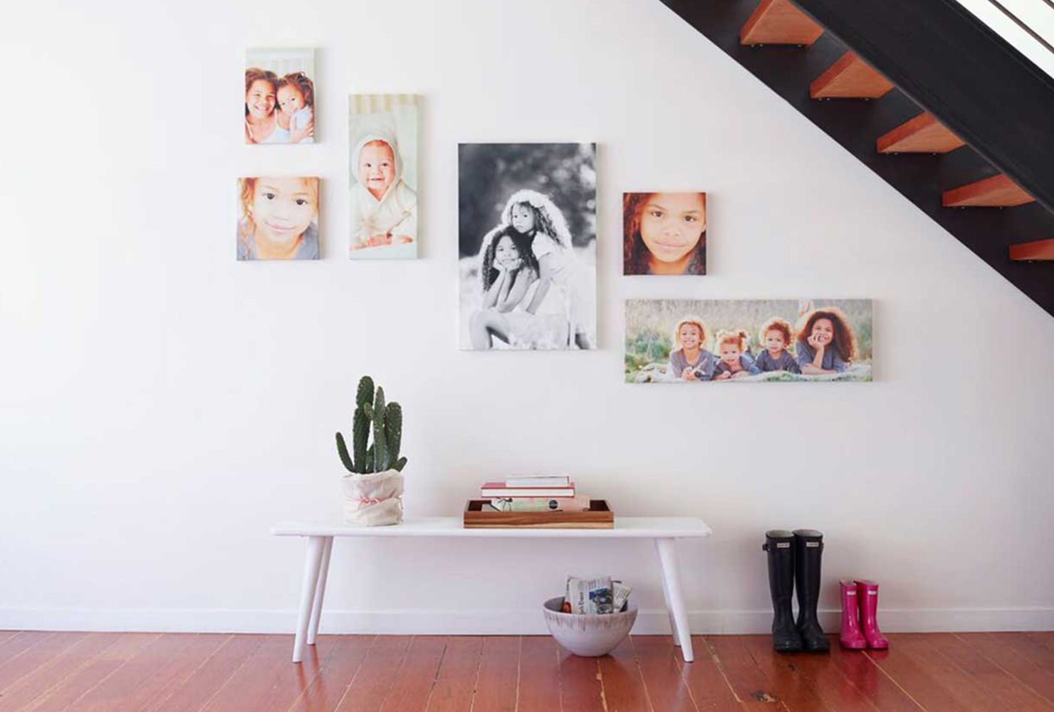 Entryway bench with canvases hanging above.