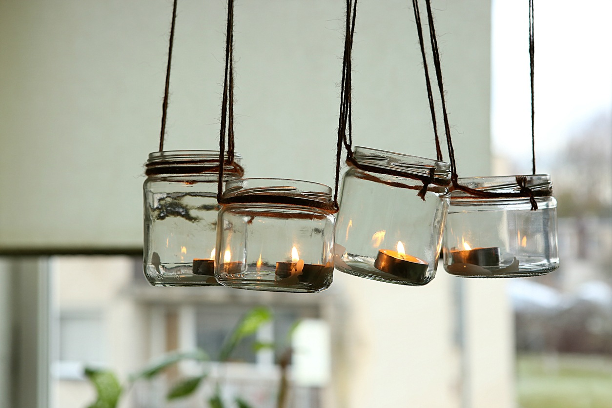 DIY candles in glass jars hanging on linen jute.