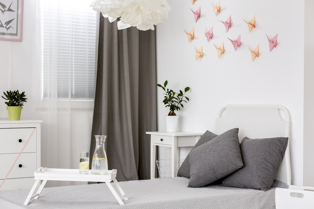 White bedroom with grey details and origami wall decor