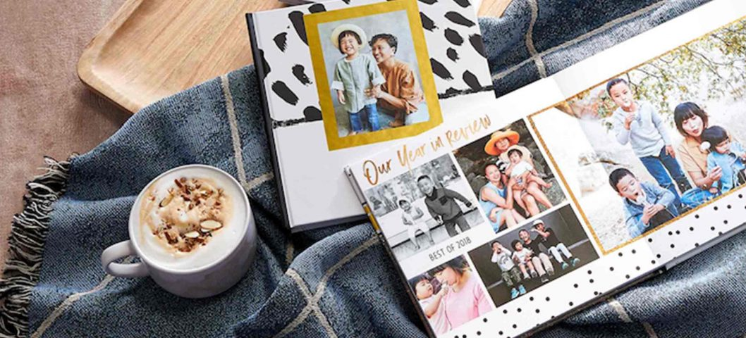 Photo books on throw blanket.