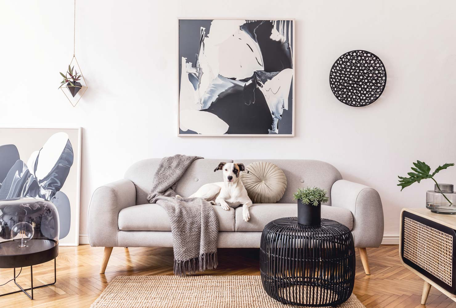 Neutral living room couch and wall decor.