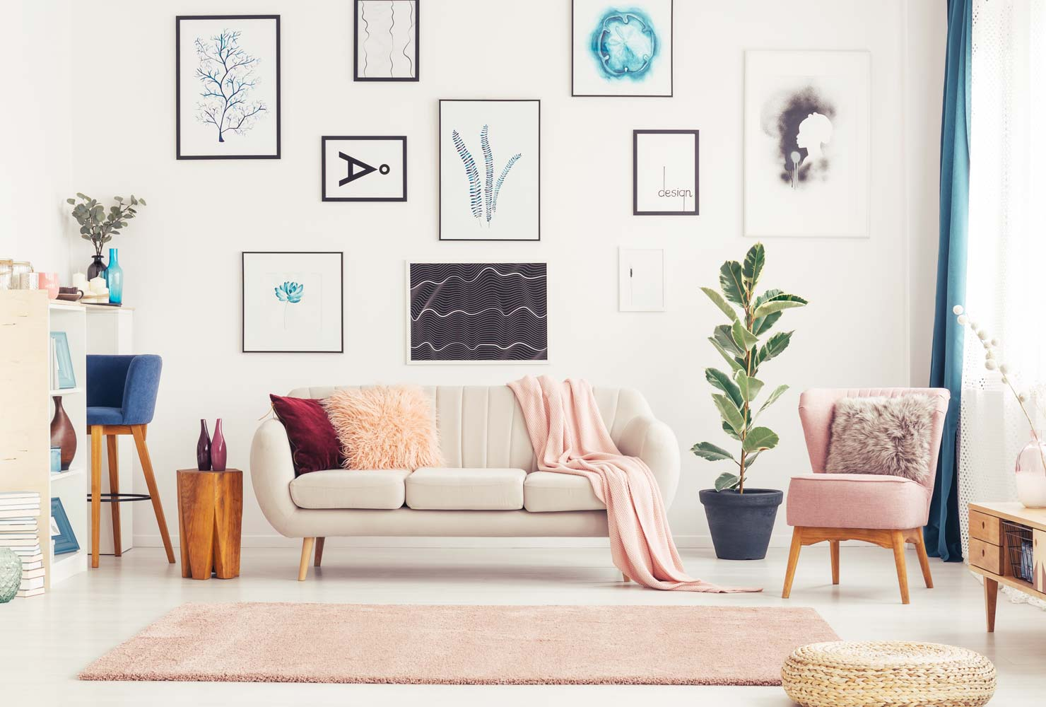 Large living room wall with art prints and colorful decor.