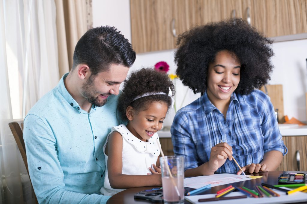 happy family painting together