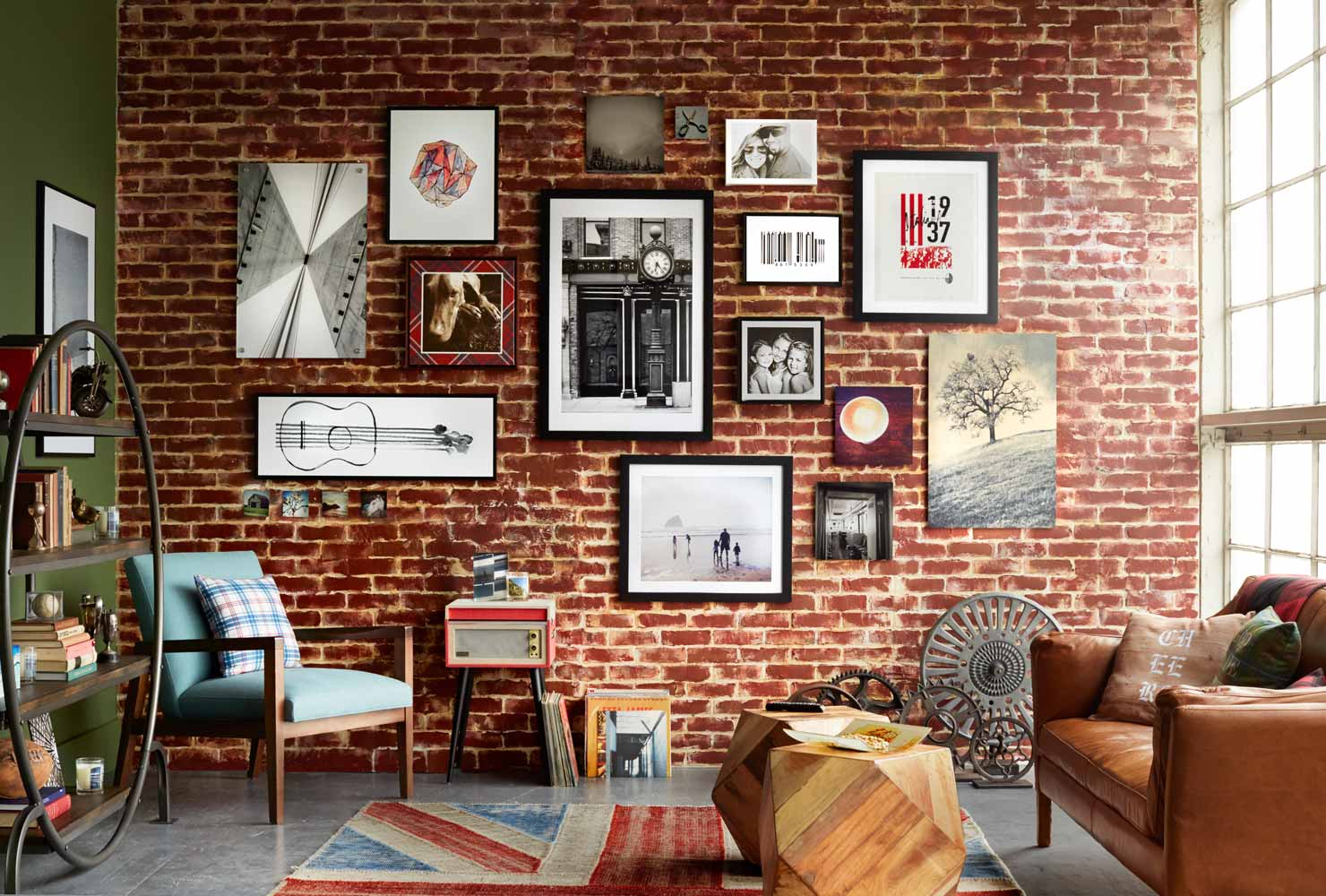 Brick wall with hanging pictures.
