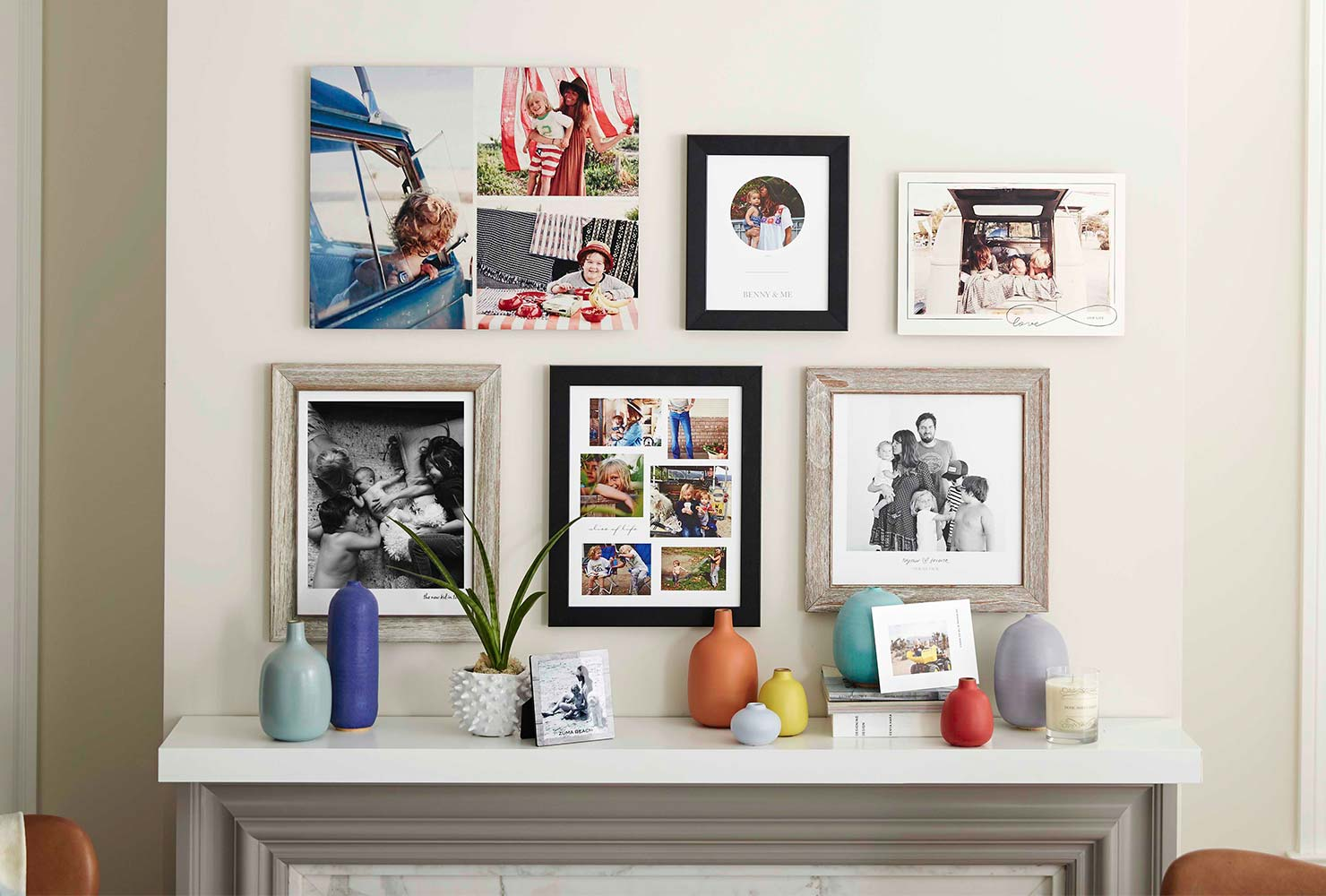 Variety of framed photos and canvas prints hanging in home