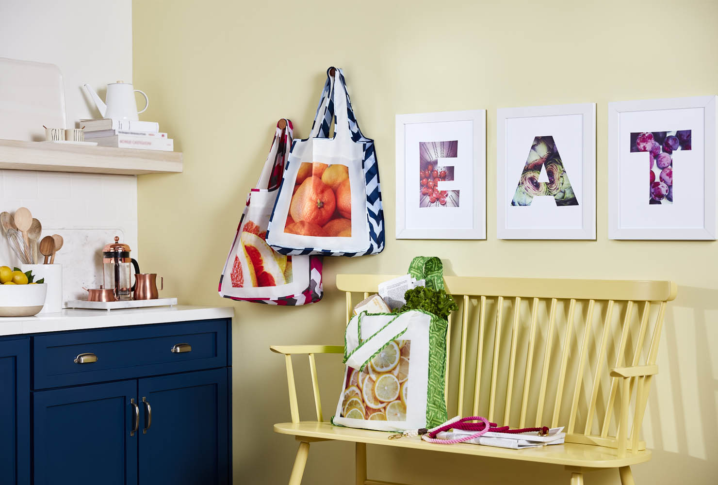 Canvas prints hanging over bench in kitchen.