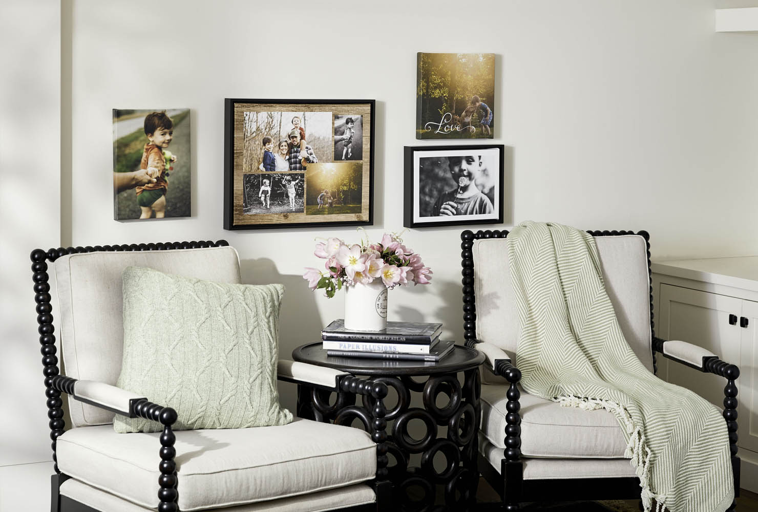 Framed prints hanging over chairs.