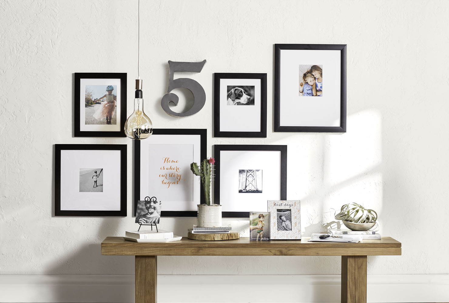 Framed gallery wall over entryway table.