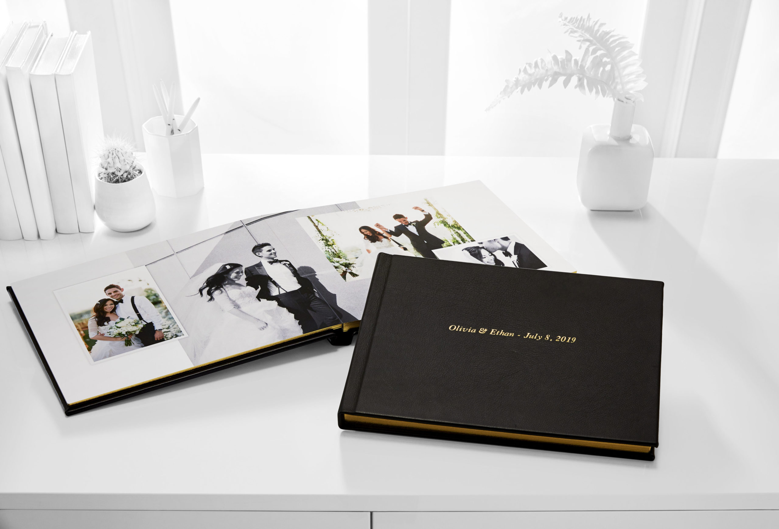 wedding photo book with pictures of the bride and groom on their wedding day