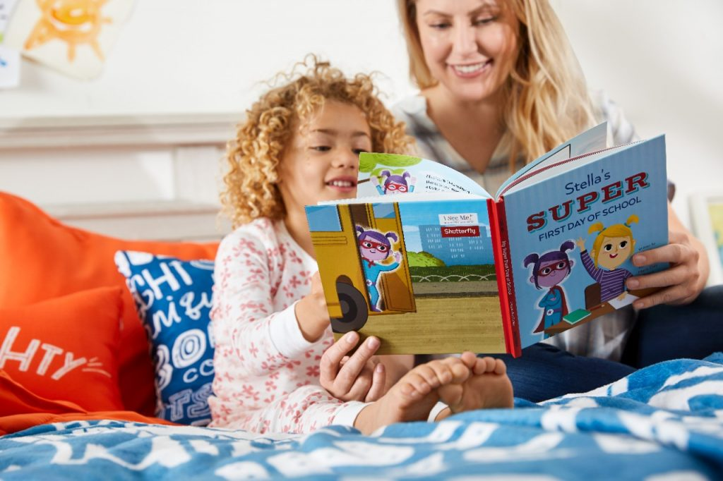 mom and daughter reading personalized story book