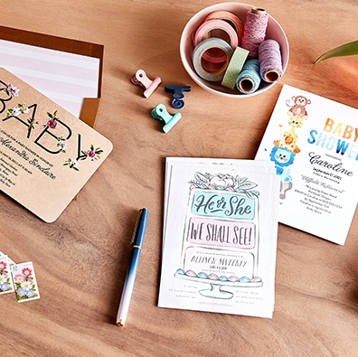 baby shower invites on table