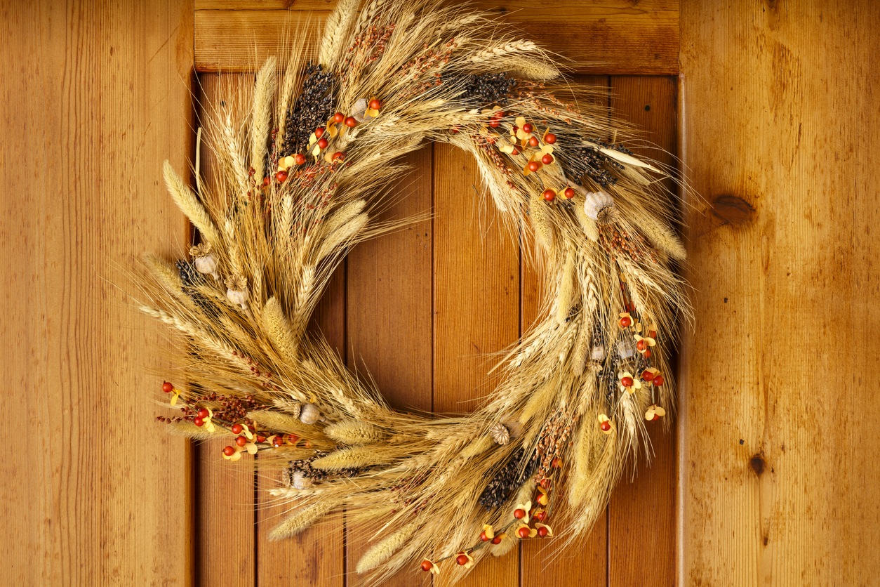 wheat wreath on the front door for fall decorating ideas