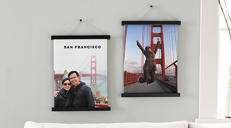 Hanging canvas prints of san francisco golden gate bridge on a gray wall