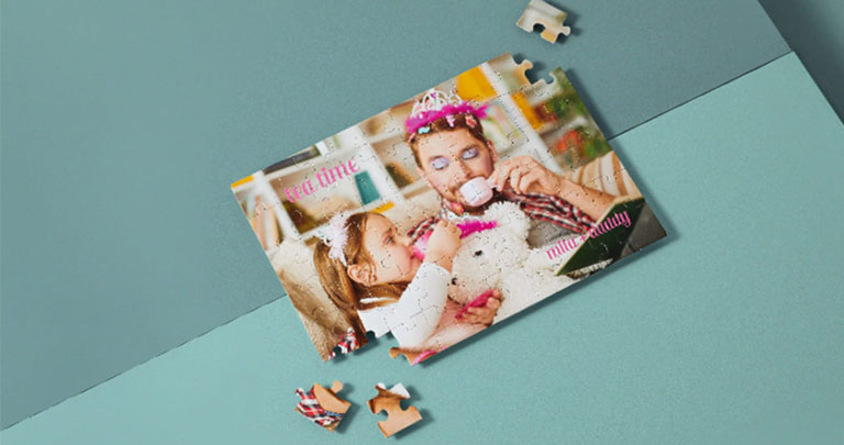 Kids photo puzzle with an image of daughter and father having a tea party
