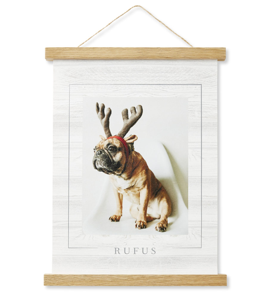 Hanging canvas with 2 natural wood rods with a dog and reindeer ears