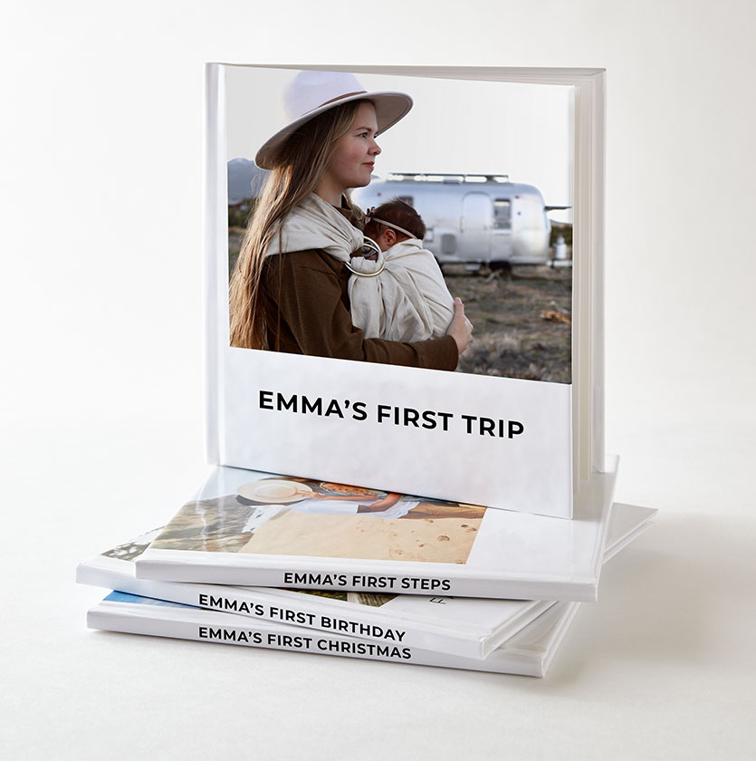 Stack of Shutterlfy instant books with photos of kids milestones