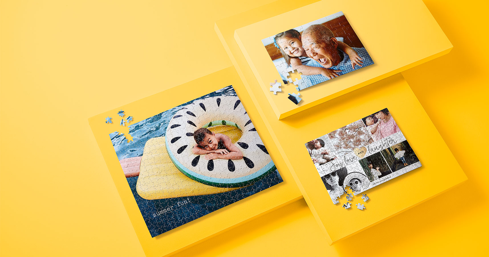 Three personalized jigsaw puzzles on yellow background. One kids puzzle, one photo of grandpa and grandkid, and one photo collage puzzle