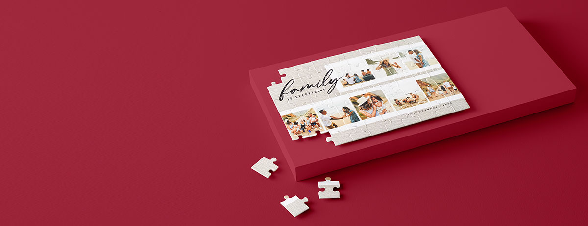 Personalized family photo jigsaw puzzle with script font and family name under collage of photos